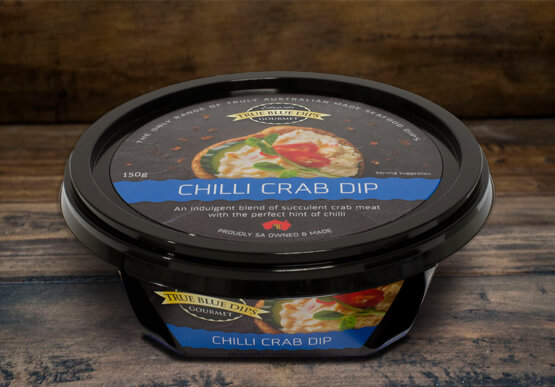 True Blue Seafood Dips, Chilli Crab Gourmet Dip in tub set on timber background scene.