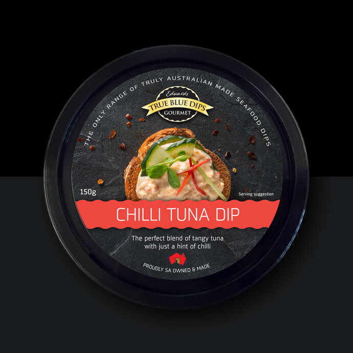 True Blue Gourmet Dips. Arial photo of Chilli Tuna Dip in black tub on black background.