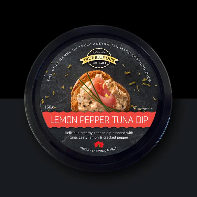 True Blue Gourmet Dips. Arial photo of Lemon Pepper Tuna Dip in black tub on black background.