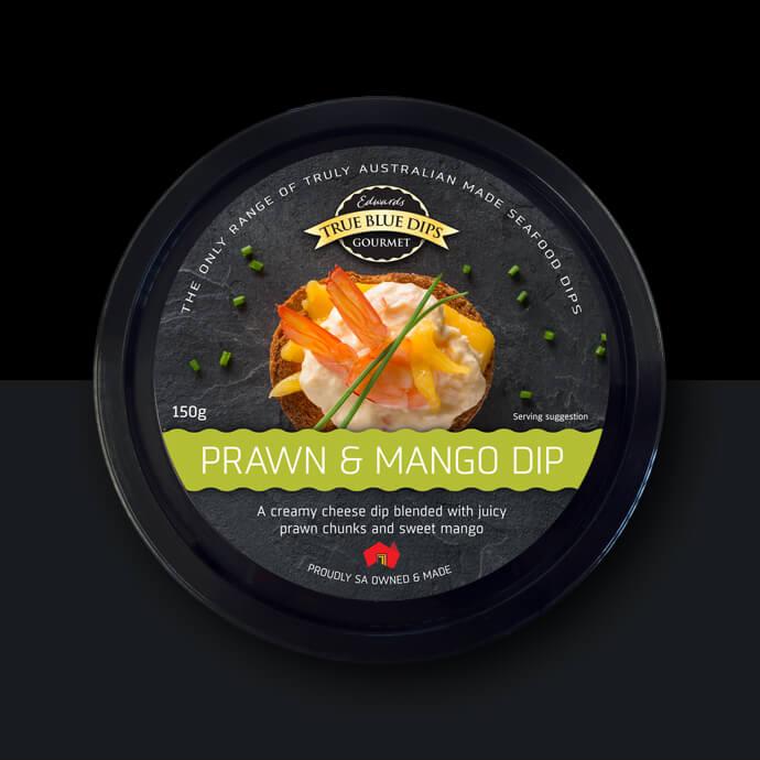 True Blue Gourmet Dips. Arial photo of Prawn and Mango Dip in black tub on black background.