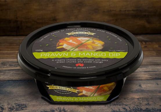 True Blue Seafood Dips, Prawn and Mango Gourmet Dip in tub set on timber background scene.