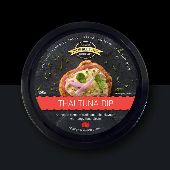 True Blue Gourmet Dips. Arial photo of Thai Tuna Dip in black tub on black background.