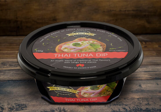 True Blue Seafood Dips, Thai Tuna Gourmet Dip in tub set on timber background scene.